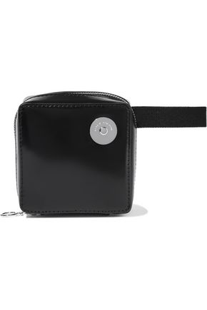 KARA Void glossed-leather belt bag
