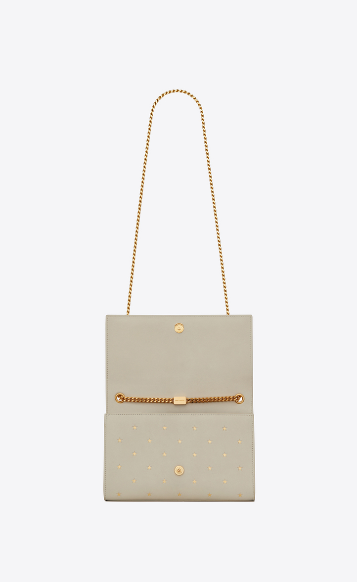 da4cf8402a66 Yves Saint Laurent - KATE Medium in grain de poudre embossed leather with a  star print