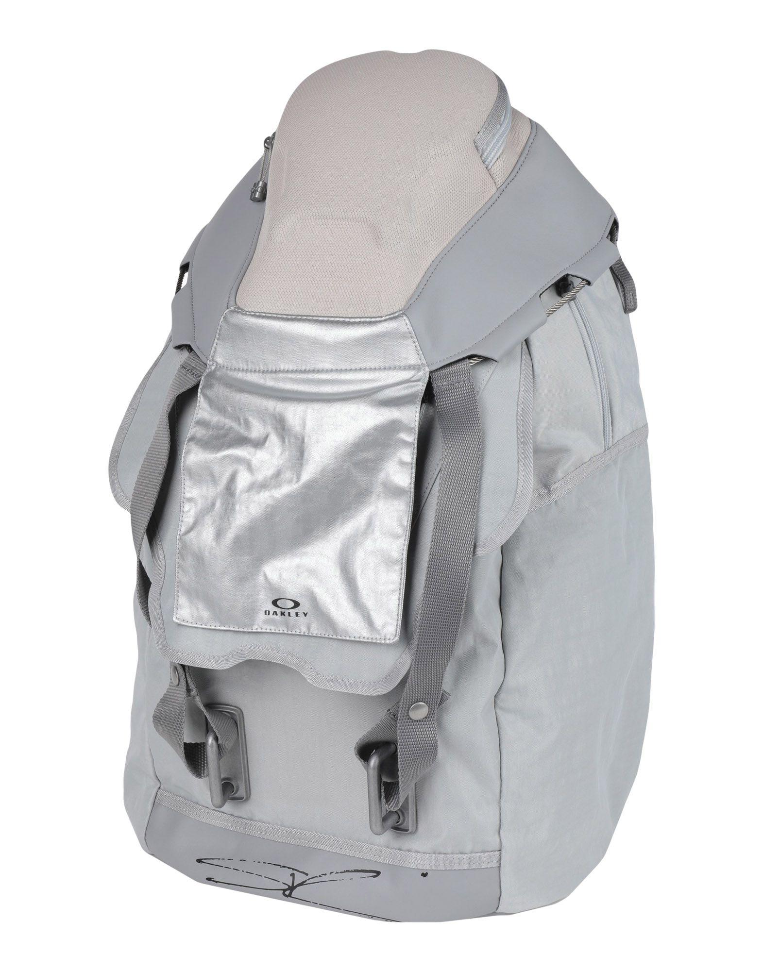 OAKLEY Рюкзаки  сумки на пояс
