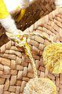 KAYU St Tropez mini pompom-embellished woven straw tote