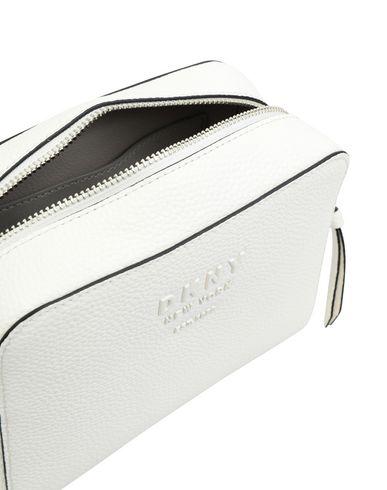 Фото 2 - Сумку через плечо от DKNY белого цвета