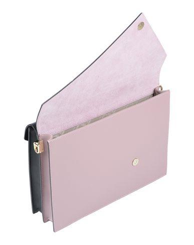 Фото 2 - Сумку через плечо розового цвета