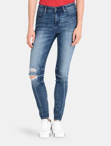 SHREDDED KNEE INDIGO SKINNY JEANS