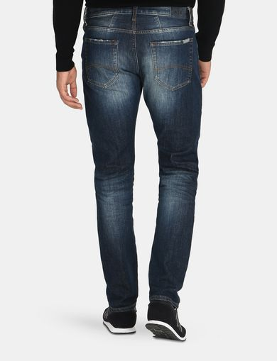 SLIM FIT WHISKERED JEANS