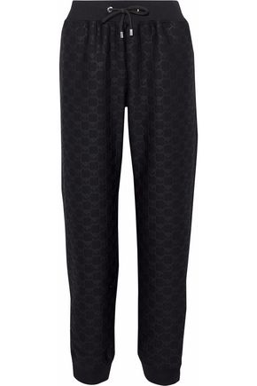 MOSCHINO Embossed tech-jersey track pants