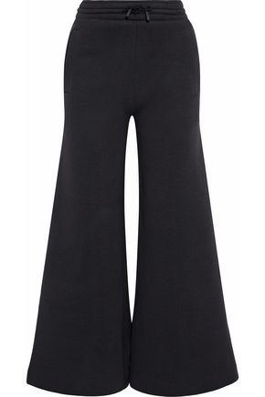 ACNE STUDIOS Cotton-blend neoprene flared track pants