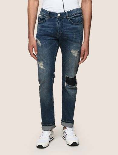 SLIM-FIT DESTROYED AND PATCHED JEANS