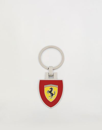 Metal keyring with enamel Ferrari Shield on a red background