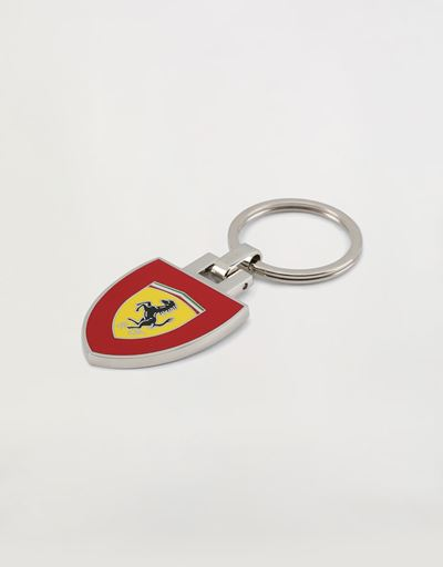 Metal key ring with enamel Shield on a red background