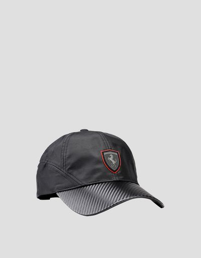 Black cap with visor with carbon fibre effect