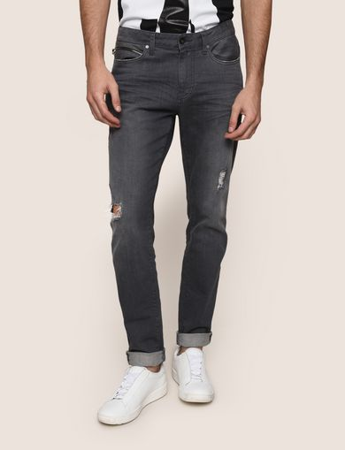 WORN THROUGH TAPERED FIT JEANS