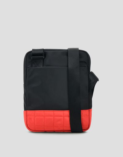 Two-tone shoulder bag featuring the Shield