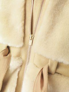 Manteau à capuche façon fourrure