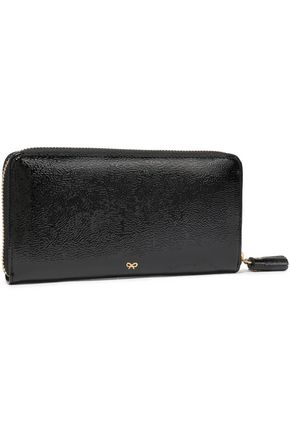 ANYA HINDMARCH Tasseled perforated patent-leather wallet