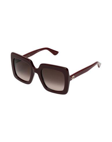 Фото - Солнечные очки красно-коричневого цвета