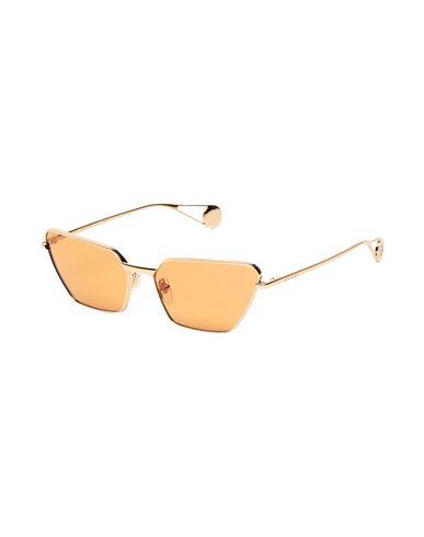 Фото - Солнечные очки золотистого цвета