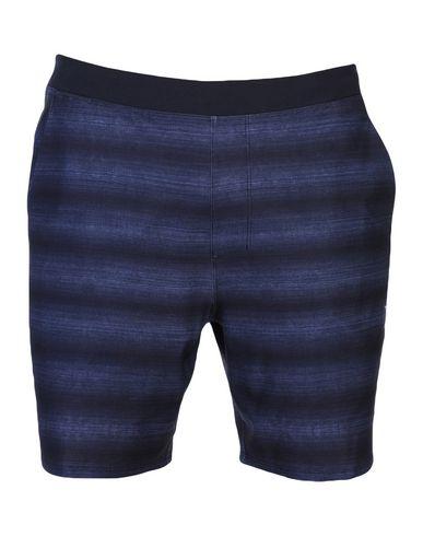 Фото - Пляжные брюки и шорты темно-синего цвета