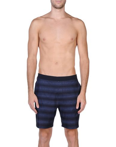 Фото 2 - Пляжные брюки и шорты темно-синего цвета