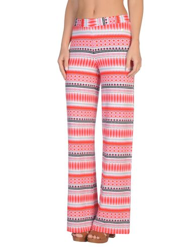 Фото - Пляжные брюки и шорты розового цвета