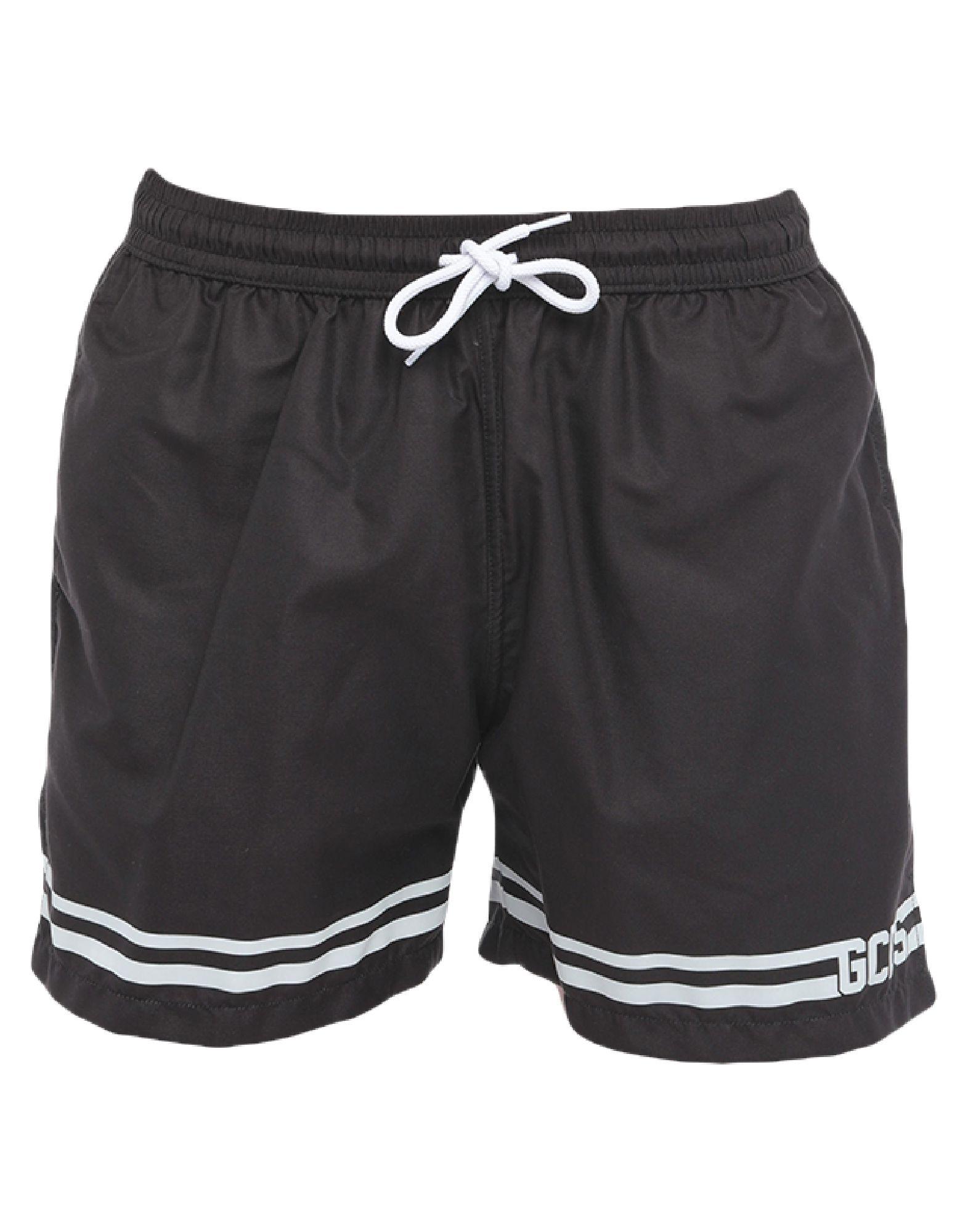 GCDS Swim trunks. techno fabric, logo, solid color, multipockets, drawstring closure, internal slip. 100% Polyester
