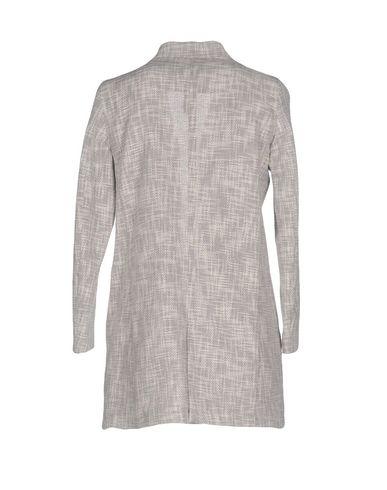 Фото 2 - Женский пиджак IANUX светло-серого цвета