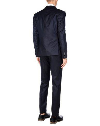Фото 2 - Мужской костюм  темно-синего цвета