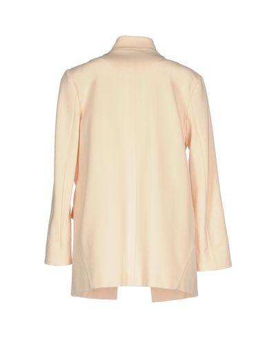 Фото 2 - Женский пиджак  светло-розового цвета