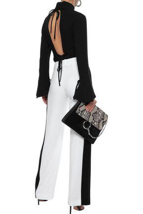 CAROLINA HERRERA Bow-detailed cutout silk turtleneck blouse
