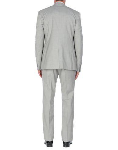 Фото 2 - Мужской костюм  светло-серого цвета