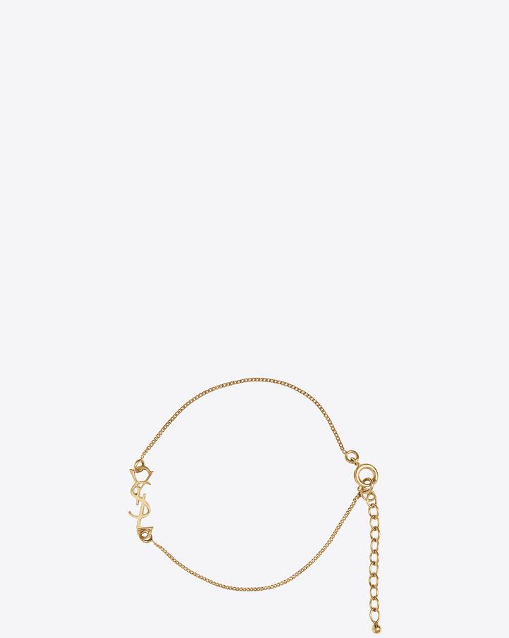 saint laurent monogram charm bracelet in gold brass