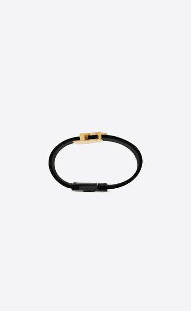 SAINT LAURENT Bracelets Woman de force bracelet in gold metal and black leather b_V4