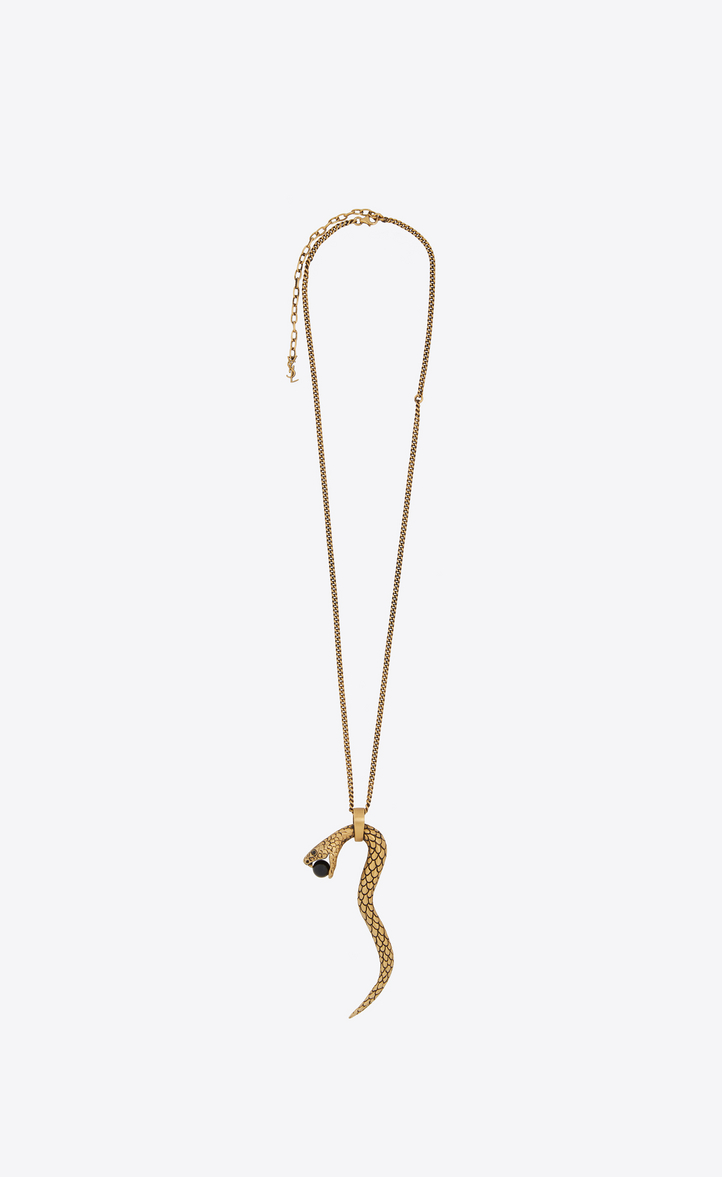 SAINT LAURENT SNAKE PENDANT IN GOLD METAL WITH A BLACK GLASS BEAD.