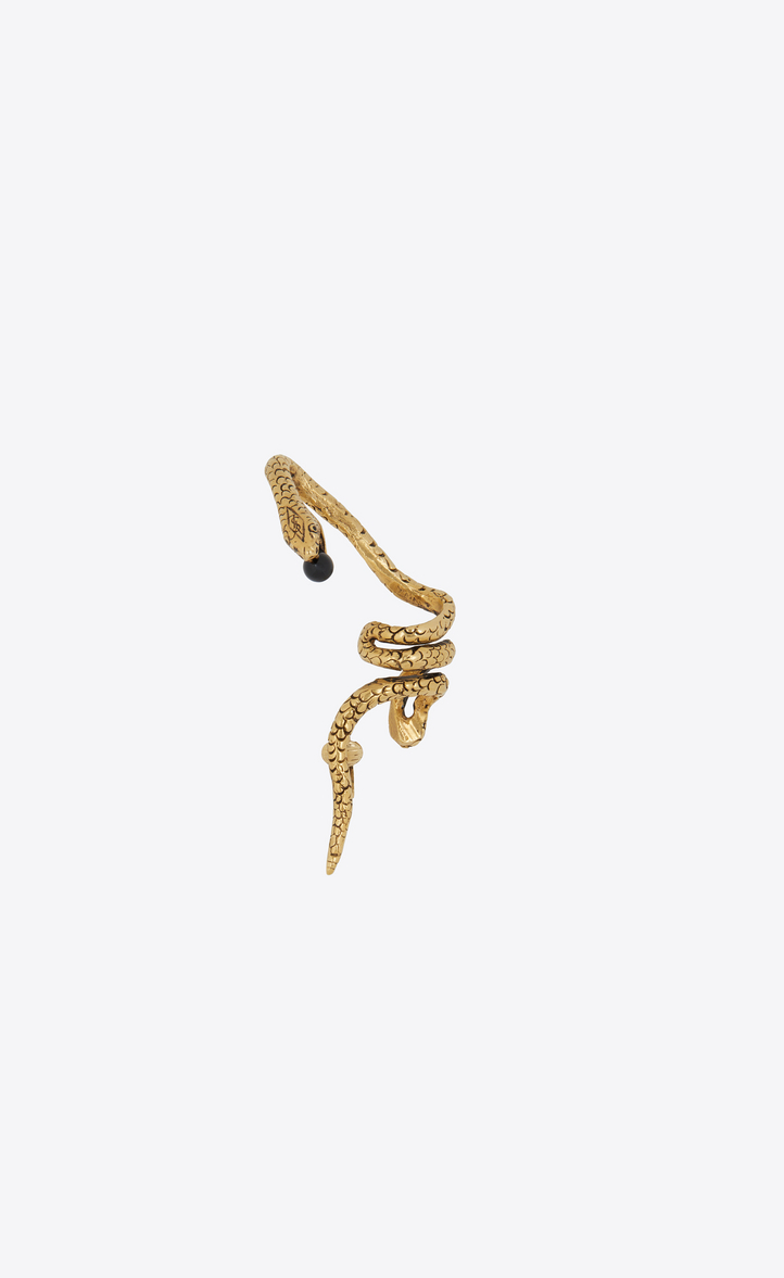 SAINT LAURENT SNAKE EAR JEWELRY IN GOLD METAL WITH A BLACK GLASS BEAD.