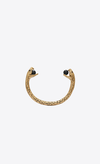 Snake bracelet in gold metal with black glass beads.