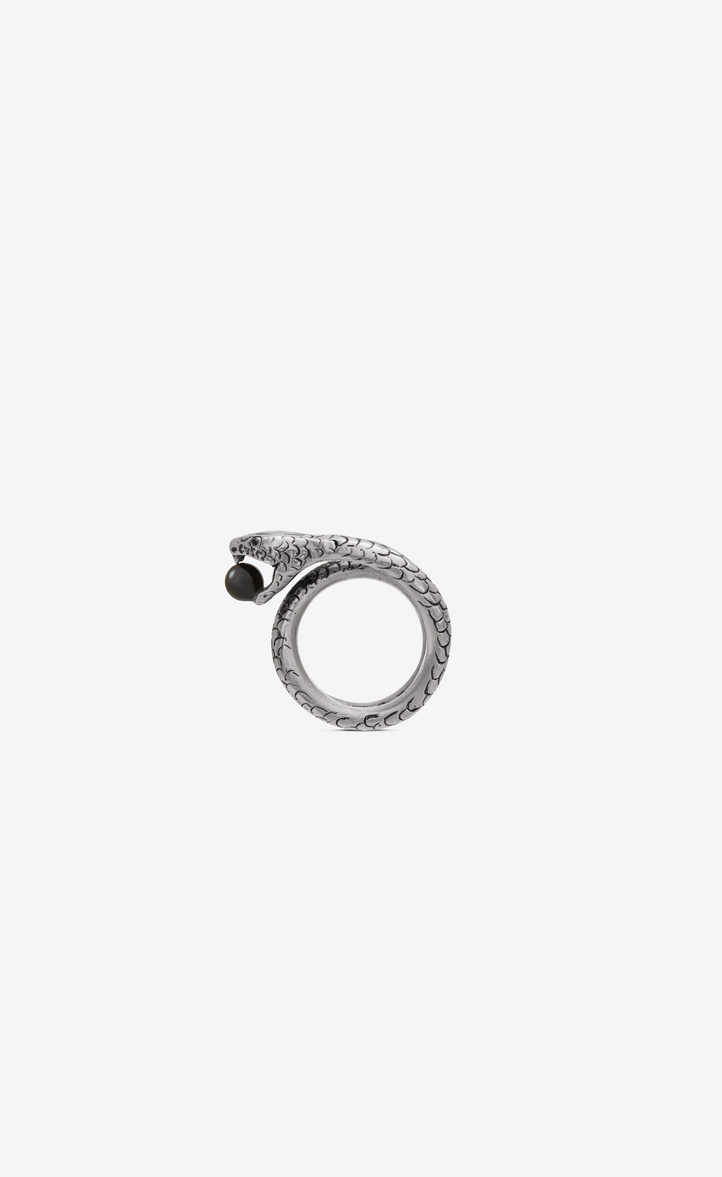 SNAKE RING IN SILVER METAL WITH A BLACK GLASS BEAD.