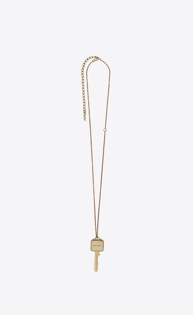 SAINT LAURENT Short Necklaces Woman Charms pendant in light gold metal a_V4
