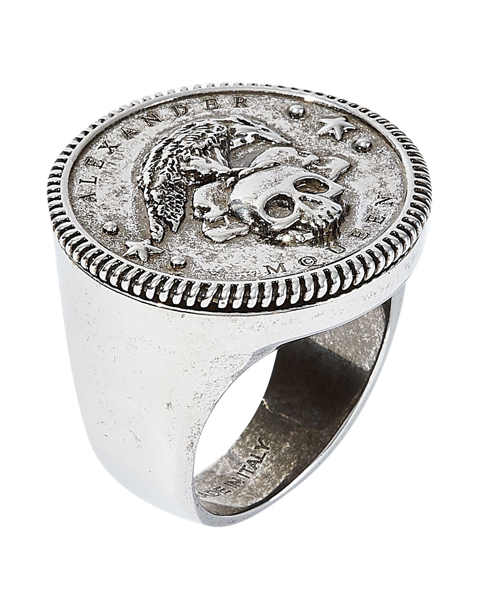 ALEXANDER MCQUEEN Rings. logo. Brass