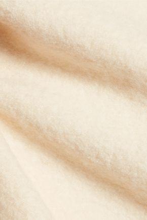 DION LEE Circle cutout merino wool turtleneck top